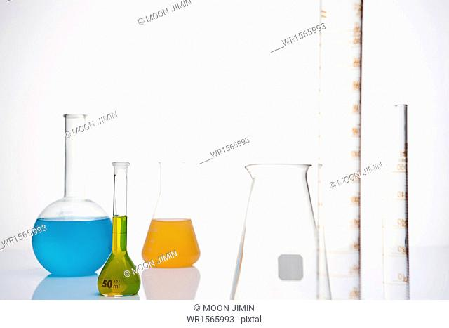several chemistry tubes with different colors of liquid