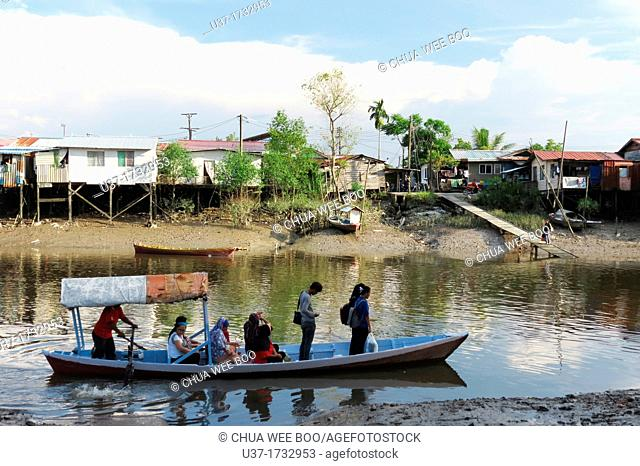 People have to cross this small river by using sampan boat and heading for the city centre. Image taken at Sungai Apong, Kuching, Sarawak, Malaysia