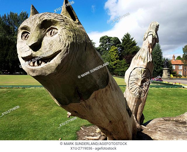 Chesire Cat and Alice in the Wooden Alice in Wonderland Sculpture in Spa Gardens Ripon North Yorkshire England