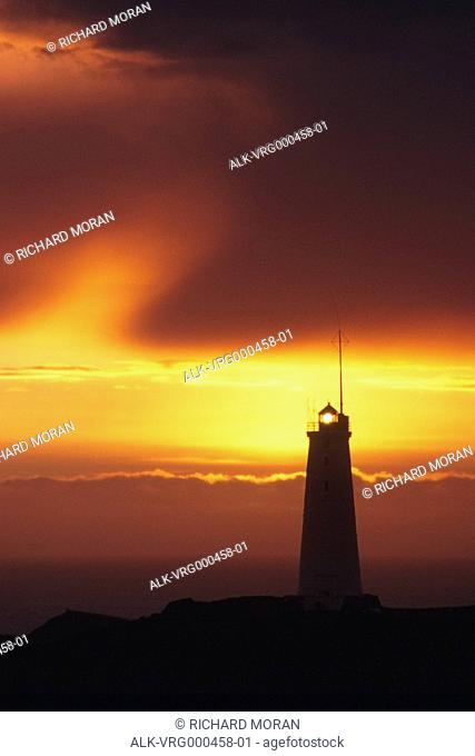 Lighthouse and sunset over the Atlantic Ocean Iceland