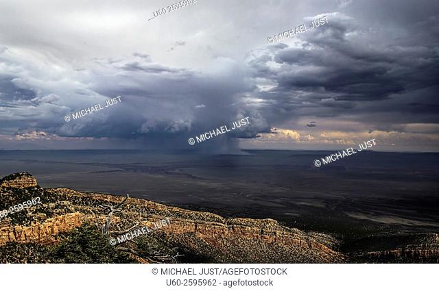 A monsoonal storm cell passes through the Northern Arizona landscape near The Grand Canyon
