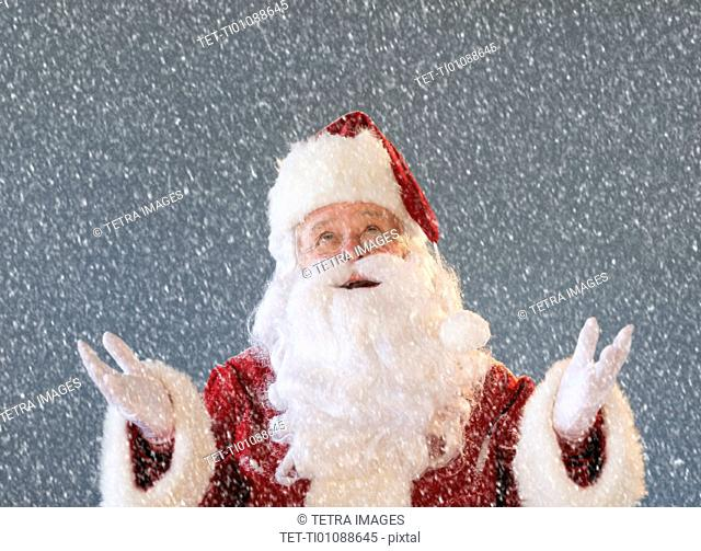 Portrait of Santa Claus looking at snow