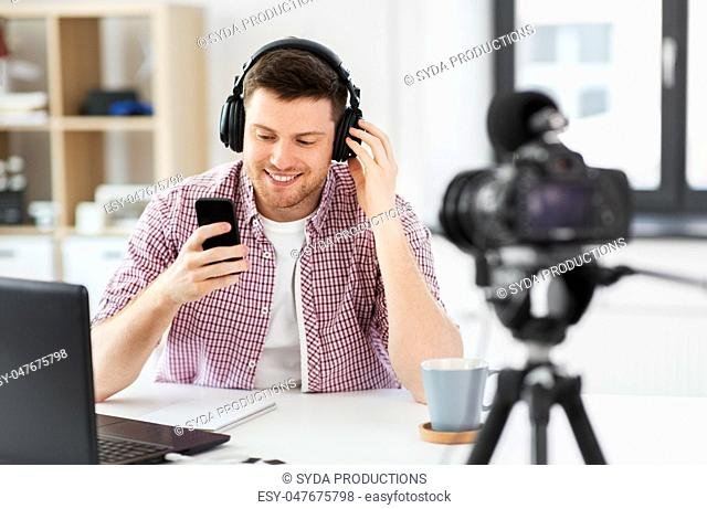 male blogger with headphones videoblogging