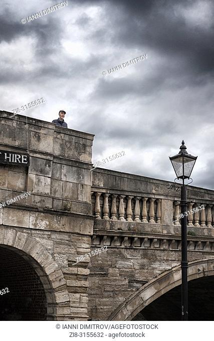 UK,Richmond Upon Thames,Surrey- pensive senior man on Richmond Bridge