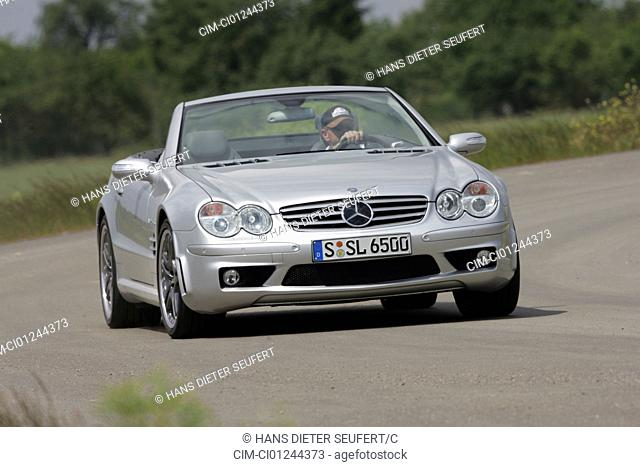Car, Mercedes SL 65 AMG, Convertible, model year 2004-, silver, Tuning, open top, driving, diagonal from the front, frontal view, country road