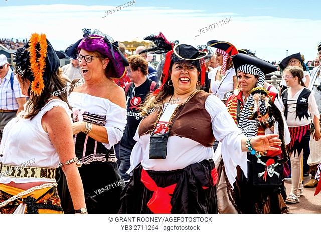 A Procession Of Pirates Passes Along The Seafront During The Annual Hastings Pirate Day, Hastings, Sussex, UK