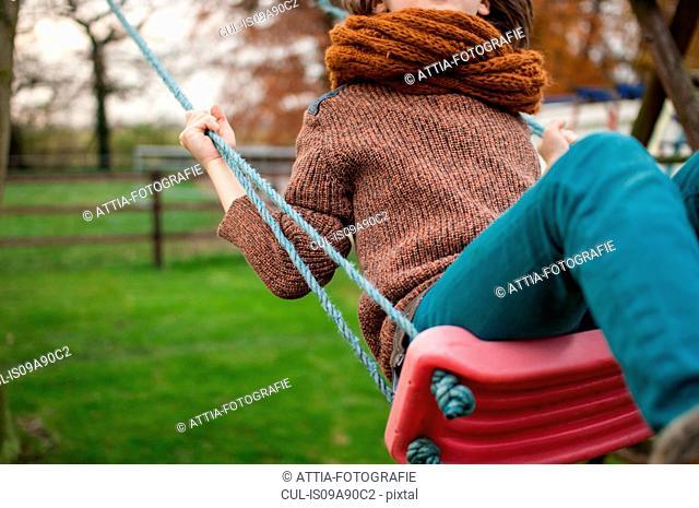 Boy on swing, close up