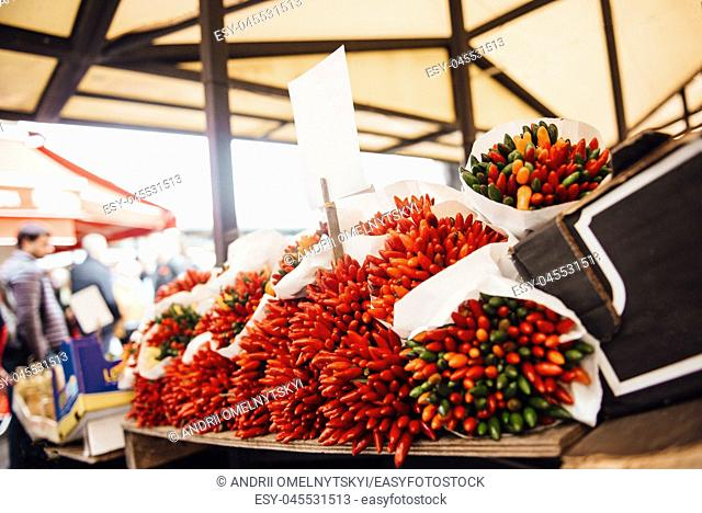 a bunch of crispy chili peppers on the market