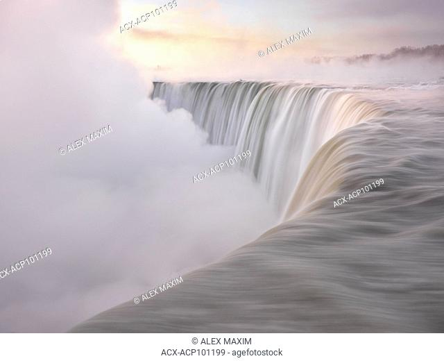 Brink of Niagara Falls Canadian Horseshoe beautiful sunrise scenery in soft light pastel colors, wintertime scenic. Niagara Falls, Ontario, Canada