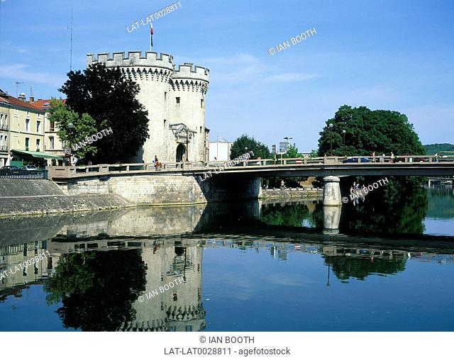 Stone gate to city called La Porte Chausse. River Meuse. Bridge. People. Trees. Buildings