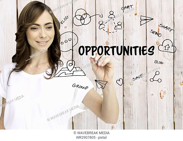 Opportunities graphic. Woman writing it. Wood background