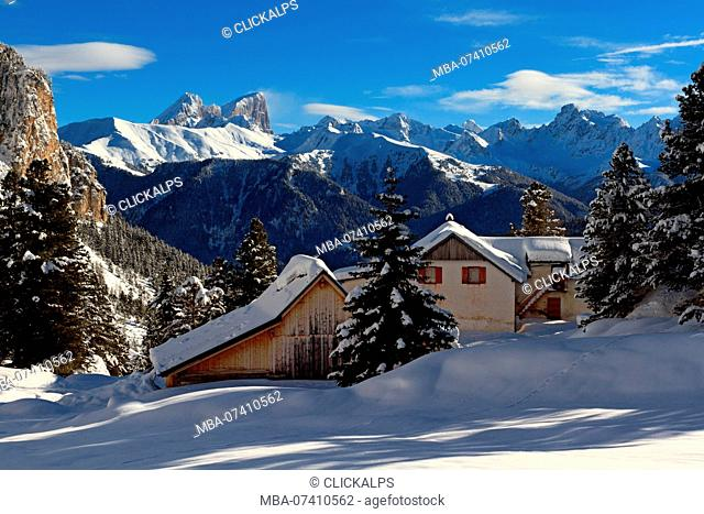 Huts near Gardeccia in Fassa valley in winter with Marmolada mount in the background, Province of Trento, Trentino Alto Adige, Italy, Europe