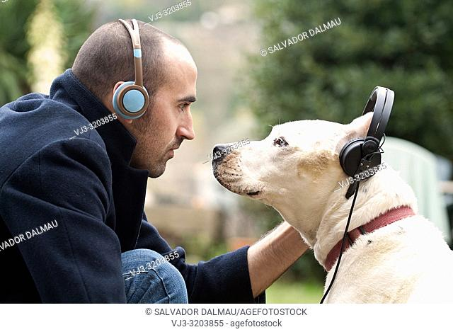 musical connection between man and dog,location figueres,girona,catalonia,spain,
