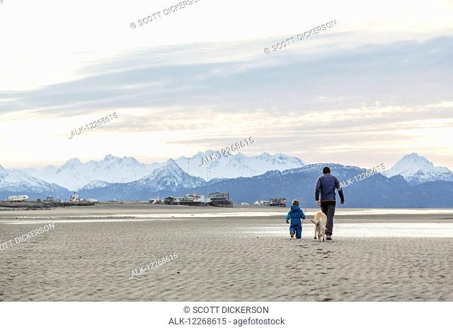 Father and son play on beach on the Homer Spit, Kenai Peninsula, Southcentral Alaska