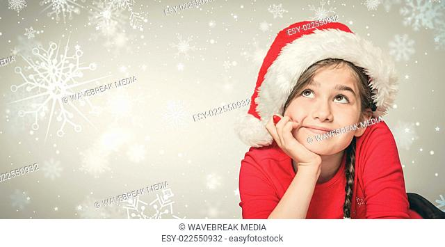 Composite image of festive girl thinking