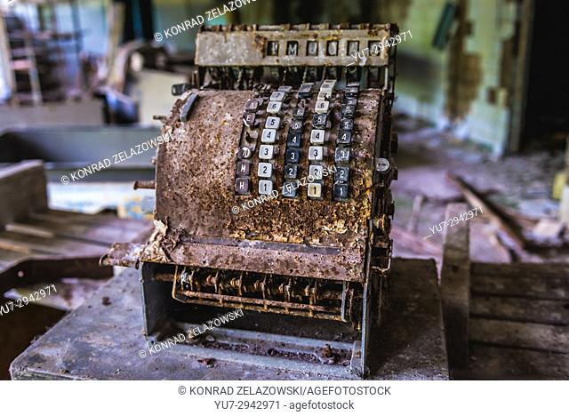 Old rusty cash register in High school No 2 in Pripyat ghost city of Chernobyl Nuclear Power Plant Zone of Alienation in Ukraine
