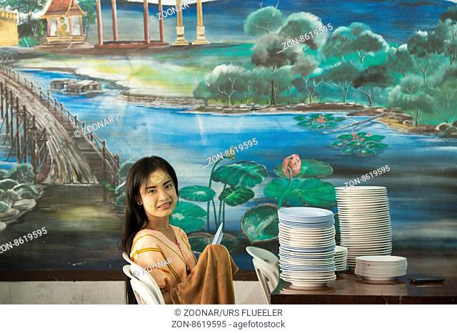 a women works in a restaurant in the Village of Thong Pha Phum north of the City of Kanchanaburi in Central Thailand in Southeastasia