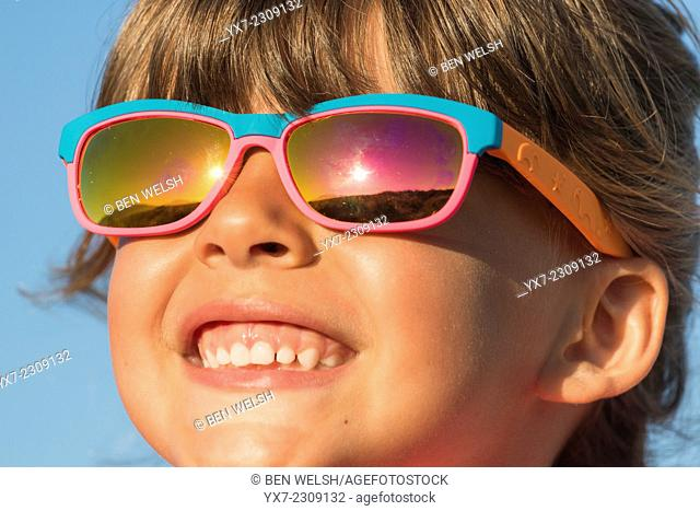 Young happy girl with sunglasses