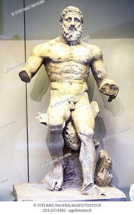 Limestone statue of Hercules resting on a rock. Roman 2nd or early 3rd century AD