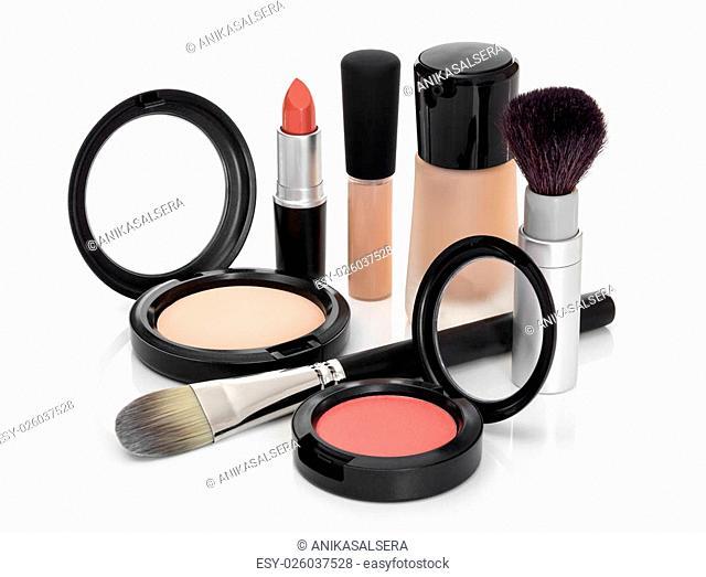 Makeup for fresh natural look. Foundation, concealer, face powder, blush, lipstick, brushes