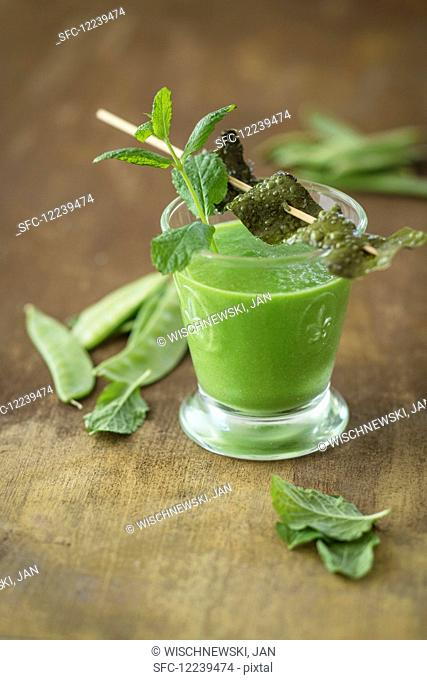A vegan shot with sugar snaps, seaweed bacon and mint (detox)