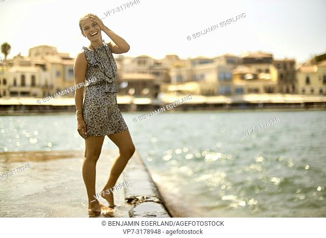 woman at harbour of Chania, Crete, Greece