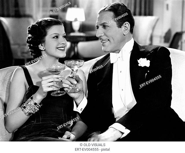 Portrait of couple having drinks All persons depicted are not longer living and no estate exists Supplier warranties that there will be no model release issues