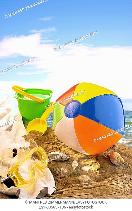 Sandy beach for swimming fun with utensils
