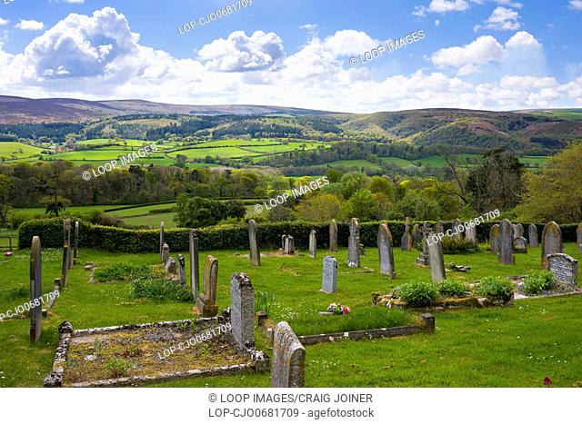 The graveyard at Selworthy village with the rolling hills of Exmoor and Dunkery Hill beyond