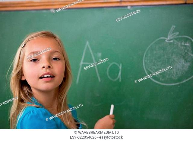 Young schoolgirl learning the alphabet