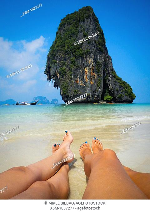 Koh Nok island and tourists in Pranang Cave Beach  Railay  Krabi province, Thailand