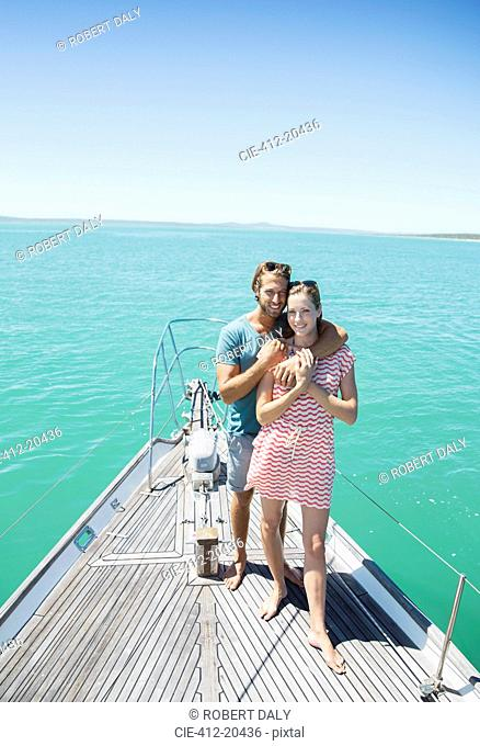 Couple standing on boat together