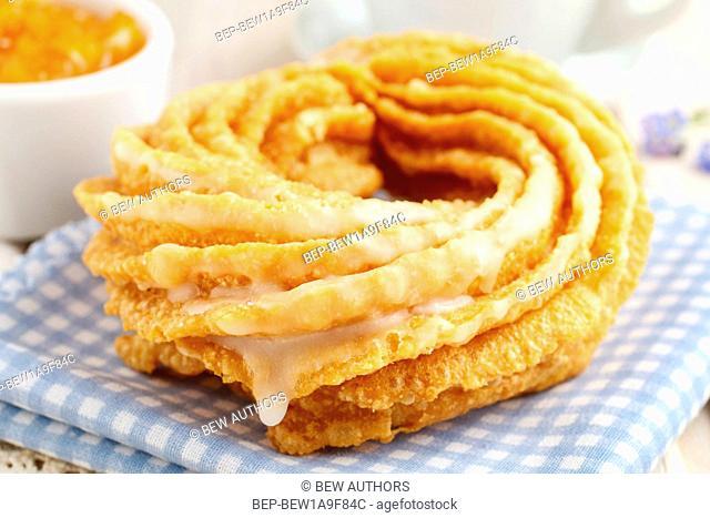 Churro donuts and bowl of honey. Spain dessert