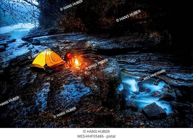 Austria, Salzburg State, Tennengau, senior man camping at Taugl brook