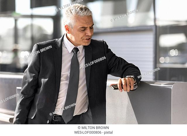 Businessman waiting at the airport check-in