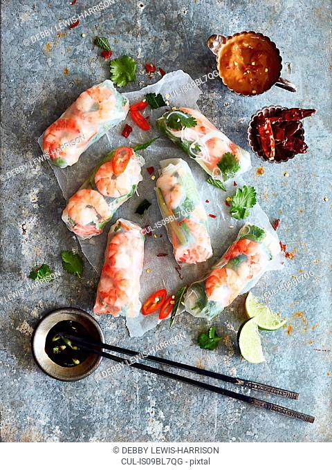 Prawn rolls on rice paper and pair of chopsticks