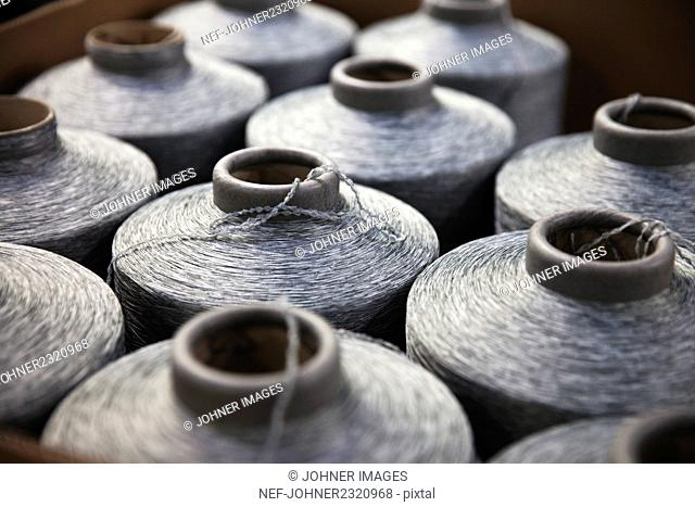 Close-up of silver spools of sewing thread