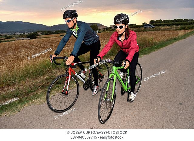 cycling couple on a road