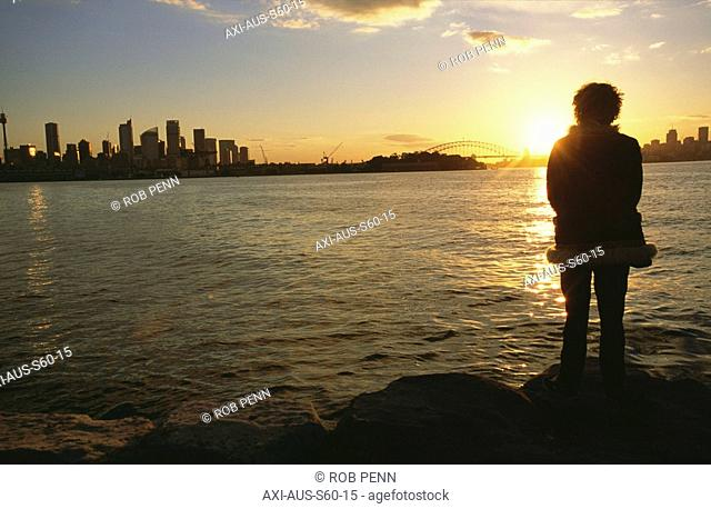 Woman watching sunset in Sydney Harbor