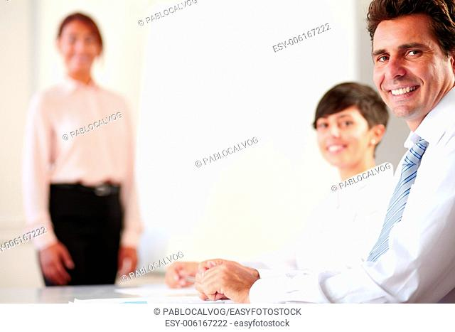 Portrait of a professional executive group smiling and looking at you on office