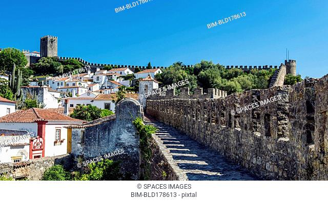 Stone walkway and Obidos cityscape, Leiria, Portugal