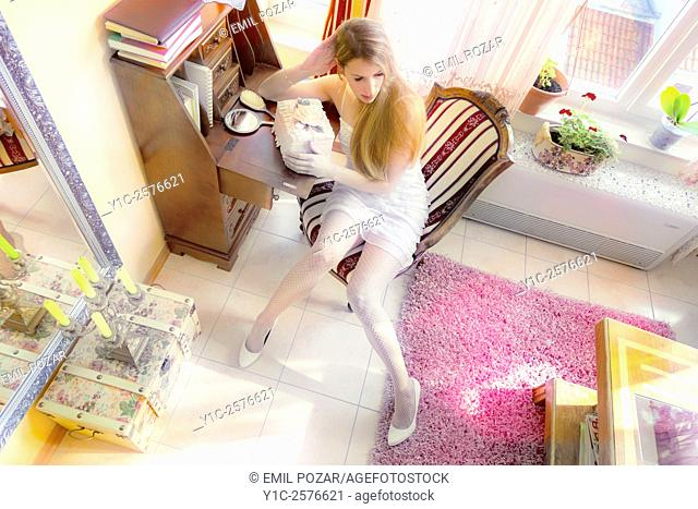 Fanciful young woman with box, artistic color