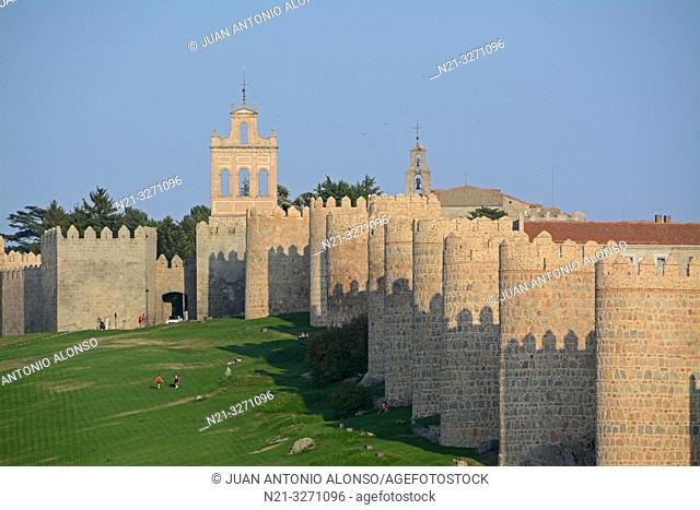 The Espadaña -bell gable- on the left and the walls of the fortified city of Avila, Castilla-Leon, Spain, Europe