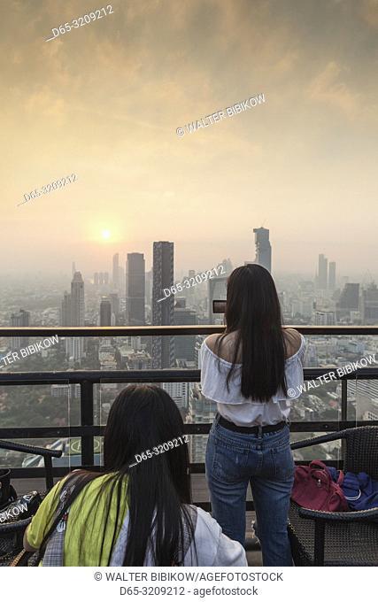 Thailand, Bangkok, Lumphini Area, patrons at the Moon Bar atop the Banyan Tree Resort Hotel, dusk, NR