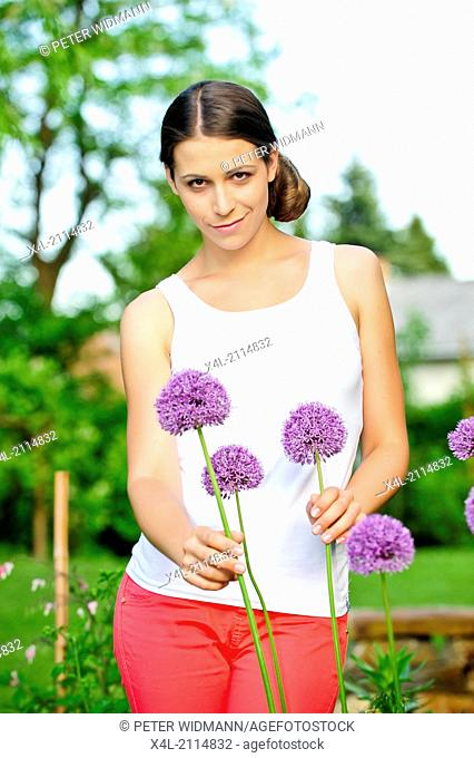 young beautiful woman in garden (model-released)