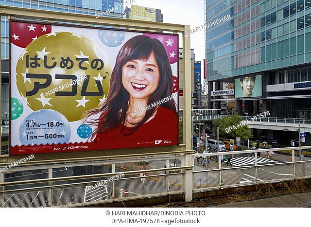Commercial hoarding on railway station in tokyo, japan