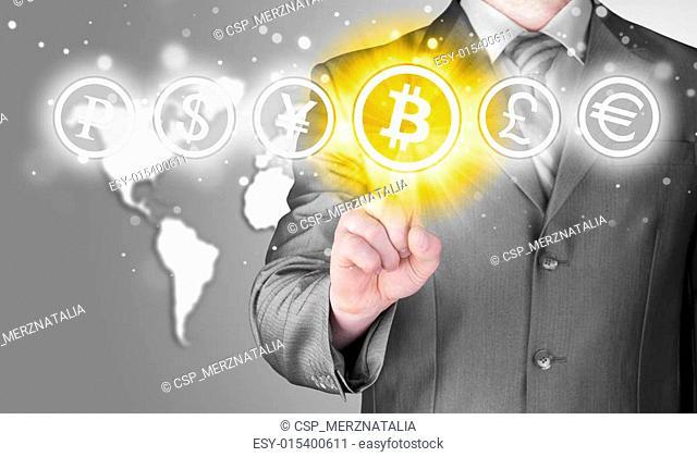 Choosing bitcoins, businessman pressing touch screen button