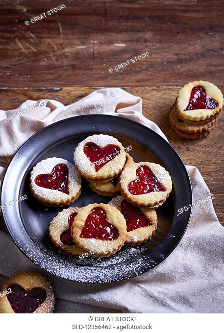 Vanilla biscuits with heart cut outs, filled with raspberry jam