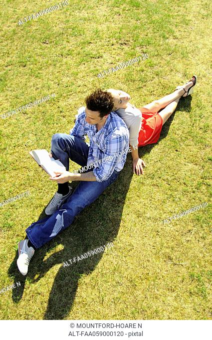 Couple relaxing together park