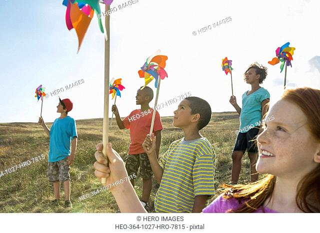 Smiling children holding pinwheels during field trip